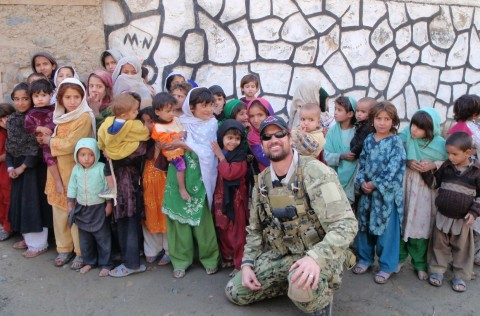 Adam with a group of Afghan children